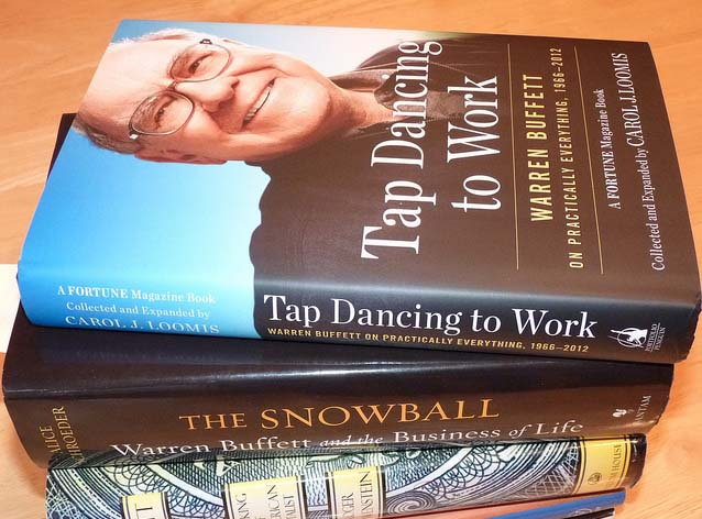 Pile of books with Warren Buffett's 'Tap Dancing To Rock' on top