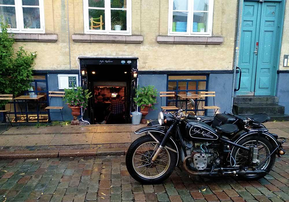 entrance sofie kaelderen with black motorcycle, Copenhagen