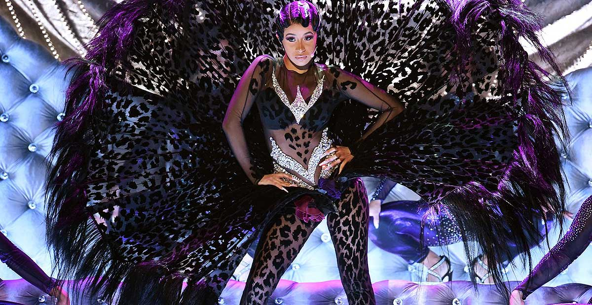 cardi b with feathers on stage at grammy 2019