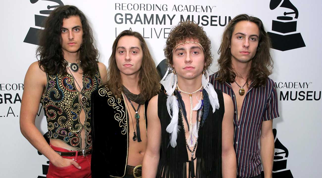 greta van fleet posing on grammy 2019 backdrop